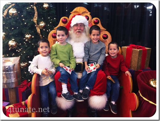 kids sitting on santa's lap for the first time