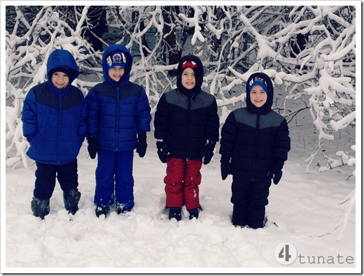 bundling up four boys for the snow